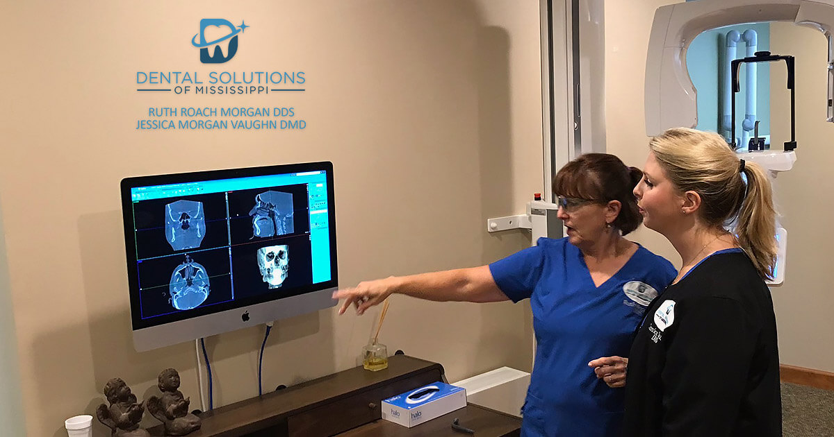 Dental solutions of mississippi Dentists discussing patients xray