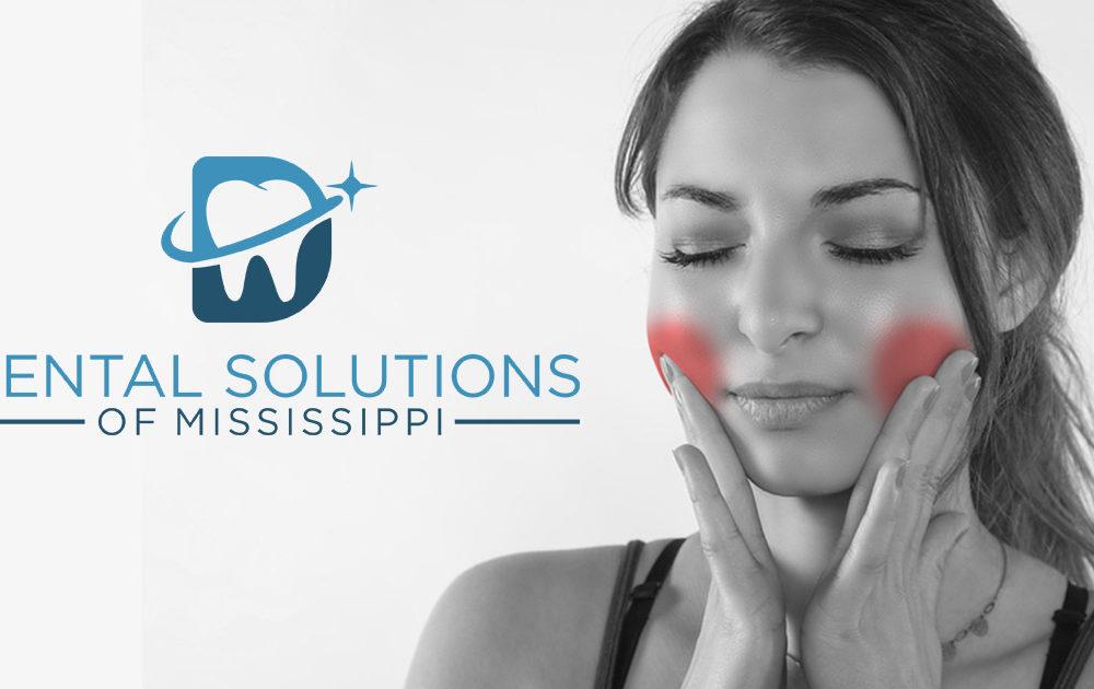 Woman feeling pain in jaw