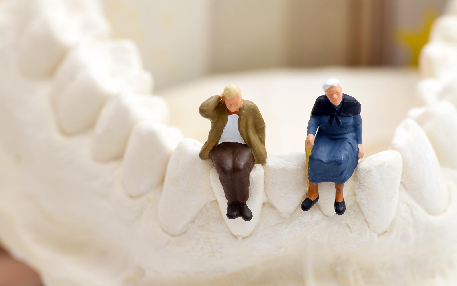 Elderly couple sitting on teeth